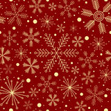 Christmas seamless pattern with various snowflakes on dark red background Stock Images