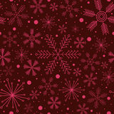 Christmas seamless pattern with various snowflakes on vinous background. Abstract Christmas seamless pattern with various snowflakes on vinous background Stock Photos