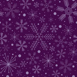 Christmas seamless pattern with various snowflakes on violet background Stock Image
