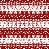 Christmas seamless pattern. Vector background. Merry Christmas and Happy New Year! Elegant seamless background with candy cane and holly. Knitted patterns in Royalty Free Stock Photos