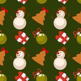Christmas seamless pattern vector illustration. Christmas seamless pattern composed of gift boxes tied with ribbon, decorative toys for festive tree, delicious Royalty Free Stock Photography