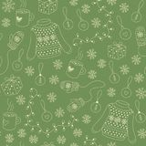 Christmas seamless pattern vector. Christmas seamless pattern with silhouettes of sweater, snowflake, gift, xmas decoration and mug of tea. Green colored. For Royalty Free Stock Images