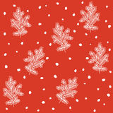 Christmas seamless pattern with white silhouettes of christmas tree branches, snowflakes Royalty Free Stock Images