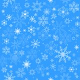 Christmas seamless pattern with white snowflakes on blue background. Graphic texture with snowflakes. Vector endless Christmas pattern Stock Illustration