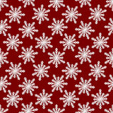 Christmas seamless pattern from white snowflakes on red backgrou Stock Photos