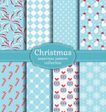 Christmas seamless patterns. Vector set. Merry Christmas and Happy New Year! Set of seamless backgrounds with traditional symbols: candy cane, snowman Royalty Free Stock Images