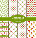 Christmas seamless patterns. Vector set. Merry Christmas and Happy New Year! Set of cute seamless backgrounds with traditional holidays symbols: bells, candy Royalty Free Stock Image
