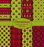 Christmas seamless patterns. Vector set. Merry Christmas and Happy New Year! Set of retro seamless backgrounds with holiday symbols: deers, christmas ball Stock Images