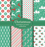 Christmas seamless patterns. Vector set. Merry Christmas and Happy New Year! Set of retro seamless backgrounds with traditional symbols: reindeer, fir-tree Royalty Free Stock Photography