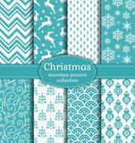 Christmas seamless patterns. Vector set. Merry Christmas and Happy New Year! Set of white and blue seamless backgrounds with traditional symbols: deer, fir-tree Stock Image