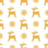 Christmas seamless texture with reindeer and snowflakes. royalty free illustration
