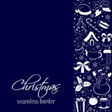 Christmas seamless vertical border. Silhouettes of winter elements and symbols on a dark blue background. Sketch hand drawing styl Royalty Free Stock Photography