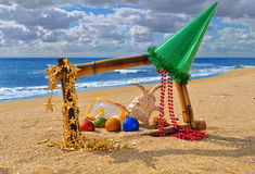 Christmas seascape in bamboo frame on the beach Stock Photo