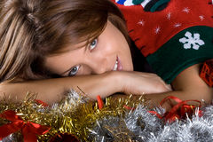 Christmas season. Brunette female model. Royalty Free Stock Photos