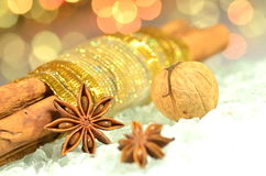 Christmas season, cinnamon sticks, anise stars and walnut Stock Images