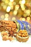Christmas season, cinnamon sticks, anise stars and walnut royalty free stock photo