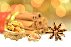 Christmas season, cinnamon sticks, anise stars and walnut Royalty Free Stock Photo