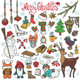 Christmas season doodle icons,animals.Colored. Christmas season doodle set.Winter decoration,snowflakes,Knitted wear,animals,birds,snowman,garlands,other holiday Royalty Free Stock Photography