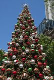 Decorated Christmas tree in Martin Place with highrise buildings in background stock photo