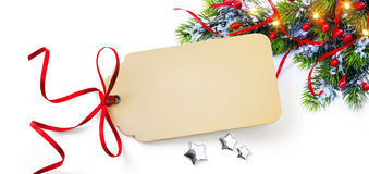 Christmas Season Gift Tag on holidays background Royalty Free Stock Images