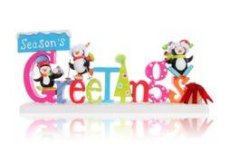 Christmas Season's Greeting Sign. A Christmas Season's Greeting sign with cute penguins over white background stock photo