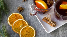 Glasses of hot mulled wine with orange and spices stock video footage