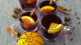 Glasses of hot mulled wine with orange and spices stock video