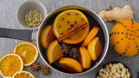 Pot with hot mulled wine, orange slices and spices stock video footage