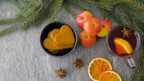 Glass of hot mulled wine, cookies, apples and fir stock video footage