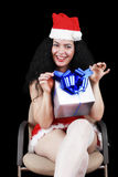 Christmas sensual brunette girl with gifts  on black Stock Photos