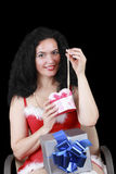 Christmas sensual brunette girl with gifts isolated on black Royalty Free Stock Image