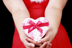 Christmas sensual brunette girl with gifts isolated on black Stock Images