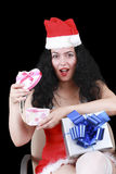 Christmas sensual brunette girl with a heart gift box, and beads Stock Photography
