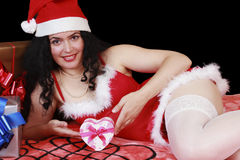 Christmas sensual brunette girl with a heart gift box Royalty Free Stock Image