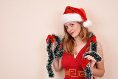 Christmas sensual girl with a big heart present, in Santa costume Stock Image