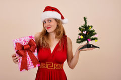 Christmas sensual girl with gift box and tree, in Sonta costume Stock Photography