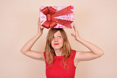 Sexy Christmas girl with gift on head Royalty Free Stock Image
