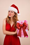 Sexy Christmas girl with gift Stock Images