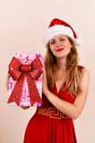 Christmas sensual girl with a present box, dressed in Santa costume Royalty Free Stock Photography