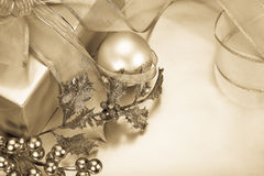 Christmas in Sepia. Beautiful sepia toned christmas gift, ribbon and decorations. Copy space royalty free stock photos