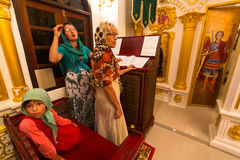 Christmas service and the vigil on Feast of the Nativity of Christ (Russian Orthodox Church). KOH CHANG - THAILAND - JAN 7, 2016: Christmas service and the vigil stock photography