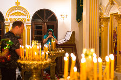 Christmas service and the vigil on Feast of the Nativity of Christ (Russian Orthodox Church). KOH CHANG - THAILAND - JAN 7, 2016: Christmas service and the vigil Stock Photo