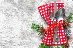 Christmas serving cutlery with napkin on white wooden background. With copy space. top view Stock Image