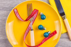 Christmas serving cutlery on plate Stock Photo