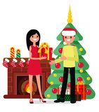 Christmas set in cartoon style. Girl gives a young man a Christmas present on the background of a fireplace, a Christmas tree and gifts Stock Photography