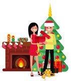 Christmas set in cartoon style. Woman and man unpack box on the background of the fireplace, Christmas trees and gifts Royalty Free Stock Image