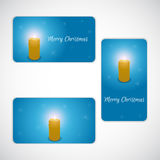 Christmas set of gift cards in three versions, with the inscription in blue and burning candle. Royalty Free Stock Photo