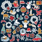 Christmas set icon elements can be used for advent. Christmas sticker icon set with gift box, xmas tree, deer, snowman, gingerbread cookie, candle, bell Royalty Free Stock Photo