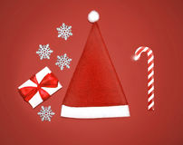 Christmas set - santa claus cap, gift box, snowflakes and candy Royalty Free Stock Photography