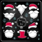 Christmas set with Santa Claus on chalkboard. Stock Photos